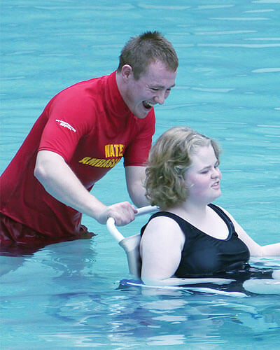 lifeguard helping pool